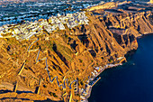 Aerial of Fira at sunset, Santorini, Cyclades, Greek Islands, Greece, Europe
