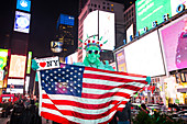 Statue of Liberty impersonators posing with tourists for tips at Times Square, Manhattan, New York City, New York, United States of America, North America