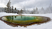 Morning Glory pool hot spring in the snow with reflections, Yellowstone National Park, UNESCO World Heritage Site, Wyoming, United States of America, North America