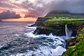 Sunset at the waterfall and cliffs of Gasadalur, Faroe Islands, Denmark, Europe