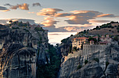Sunset light on clouds and Varlaam and Megalo Meteoro Monasteries, Meteora, UNESCO World Heritage Site, Thessaly, Greece, Europe