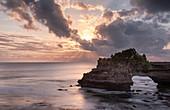 Sunset on Batu Bolong temple on a natural arch in the sea, Bali, Indonesia, Southeast Asia, Asia