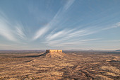 Desert landscape of Damaraland with a lonely rock in the middle, Namibia, Africa