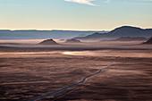 Rocky desert at sunrise taken from a hot air balloon flight, Namibia, Africa