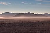 Misty sunrise in the rocky desert, Namibia, Africa