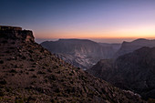 Blue hour on the rocky landscape of Jebel Akhdar mountains in Oman, Middle East