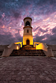 Sur lighthouse at sunset with purple clouds, Sur, Oman, Middle East