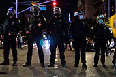 Heavily Geared NYPD Officers at Night, Greenwich Village, New York City, New York, USA