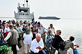 An old ferry brings tourists to the shore, river cruise ship MS Michail Svetlov, river cruise on the Lena, Yakutia: ASIA, Russia, Sacha, Republic of Sakha, Yakutia,