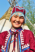 Young people in traditional costumes for tourist presentations. Shigansk is a settlement on the lower reaches of the Lena, where it crosses the Arctic Circle on its way to the Arctic Ocean. It was founded in 1632. The population lives mainly from fur hunting, reindeer herding and fishing. Young Yakutin, Yakutia: ASIA, Russia, SACHA, YAKUTIA, Republic of Sakha (Yakutia), Lena River