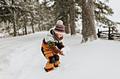 Canada, Ontario, Girl (2-3) playing with snow