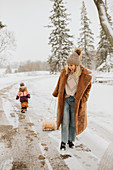 Canada, Ontario, Mother and daughter (2-3) on winter walk