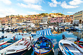 Harbour of Portoferraio, boats moored close together and buildings on the hillside
