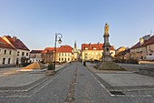 Poland,Opole,Toszek,Historic town square with statue at dusk