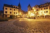Poland,Pomerania,Lebork,Illuminated town square at night