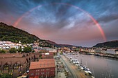 Norway,Western Norway,Bergen,Rainbow over city and fjords at sunset