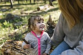 Little daughter (2-3) with her mother camping in Uinta-Wasatch-Cache National Forest