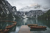 Italy,Pragser Wildsee,Dolomites,South Tyrol,Rowboats moored near jetty in mountain lake