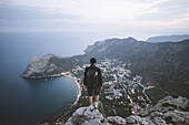 Italy,Liguria,La Spezia,Man looking at mountain range from mountain top