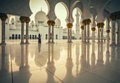 United Arab Emirates,Abu Dhabi,Sheik Zayed Grand Mosque,Woman photographing Sheikh Zayed Grand Mosque