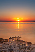 Greece,Cyclades Islands,Mykonos,Chora,Aerial view of sea and coastal town at sunset