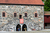 People with medieval clothing in front of the Archbishop's Palace, Trondheim, Norway