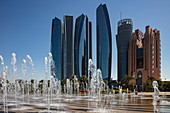 Skyscrapers seen from the fountain below the Emirates Palace Hotel, Abu Dhabi, Abu Dhabi, United Arab Emirates, Middle East