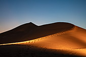 Illuminated sand dune outside Arabian Nights Village desert resort at dusk, Arabian Nights Village, Razeen Area of Al Khatim, Abu Dhabi, United Arab Emirates, Emirates, Middle East