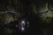 Visitors canoe through caves of the underground river in the Puerto Princesa Subterranean River National Park, Cabayugan, Puerto Princesa, Puerto Princesa, Philippines, Asia