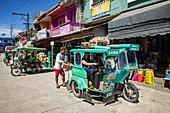 Shopping goods are loaded into a three-wheeled rickshaw in Romblon Town, Barangay I, Romblon, Romblon, Philippines, Asia