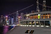 Bridge of cruise ship Silver Shadow at Hong Kong Cruise Terminal with city skyline at night, Hong Kong, Hong Kong, China, Asia