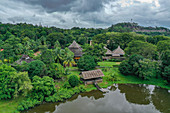 Aerial view of lake, huts and jungle in the Sarawak Cultural Village, Kampung Budaya Sarawak, near Kuching, Sarawak, Borneo, Malaysia, Asia,
