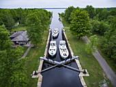 Aerial view of three Le Boat Horizon houseboats in Beveridge Locks, near Lower Rideau Lake, Ontario, Canada, North America