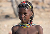 Angola; western part of the province of Cunene; young girl from the Mucohona ethnic group; with typical head and neck jewelry