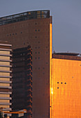 Angola; Luanda Province; Luanda; Capital of Angola; modern office building in the center; The glass facade reflects the sunset
