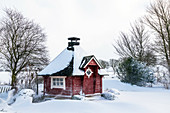 Finnish Saunakota in a snow storm, Georgshof, Ostholstein, Schleswig-Holstein, Germany
