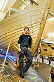 Boat builder in the museum and boatyard for Nordland boats, Viking Museet Stadsbygd, Trondelag district, Norway