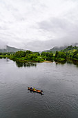 Salmon anglers with wooden boats on the Namdalen River, Grong, Norway