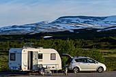 Caravan in parking lot in Saltfjell by the E6, Norway