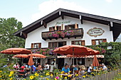 Terrace in the cottage garden of Cafe Giggerer, Kochel am See, Upper Bavaria, Bavaria, Germany