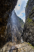 View through waterfall in the Höllentalklamm, Grainau, Upper Bavaria, Germany