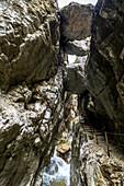 View through the rock faces and the Hammersbach in the Höllentalklamm, Grainau, Upper Bavaria, Germany