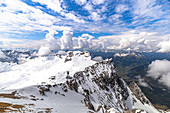 View from Zugspitze summit on glacier and mountain landscape in the snow, Grainau, Upper Bavaria, Germany