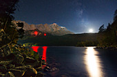 Night sky with moon and Milky Way at Eibsee, view to Zugspitze, Werdenfelser Land, Bavaria, Germany