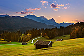 Dusk, view of the Zugspitze massif with Alpspitze, Zugspitze and Waxenstein, Werdenfelser Land, Bavaria, Germany
