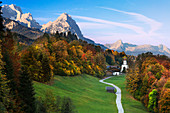 View of the church village Wamberg, with Zugspitze Waxenstein and Daniel in the background, Werdenfelser Land, Bavaria, Germany