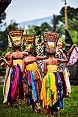 Adolescent Balinese girls dancing in temple grounds during the festival of Galungan and Kuningan, Karangasem, Bali, Indonesia