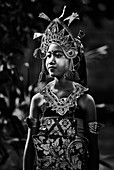 A portrait of a young Balinese female dancer at her family compound in Ubud, Bali Indonesia