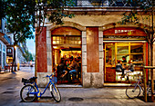 A street scene of a bar and patrons in Bormuth in the Born district at dusk, Barcelona Catalonia Spain