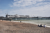 Brighton Beach and a view of the Brighton Pier on a spring day, Brighton, East Sussex, UK.